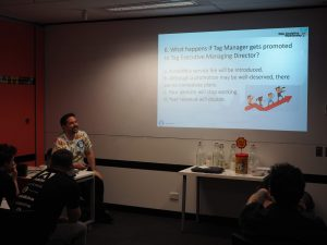 measurecamp presentation joke on promotion of a tag manager to a tag executive